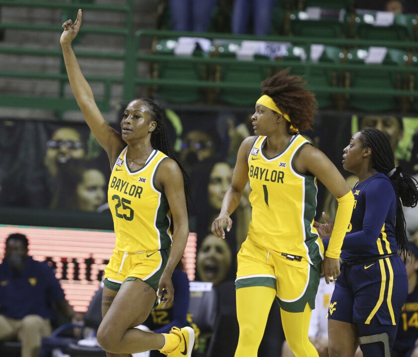Baylor center Queen Egbo, left, celebrates her score over West Virginia with teammate NaLyssa Smith in the first half of an NCAA college basketball game, Monday, March 8, 2021, in Waco, Texas. (Rod Aydelotte/Waco Tribune Herald, via AP)