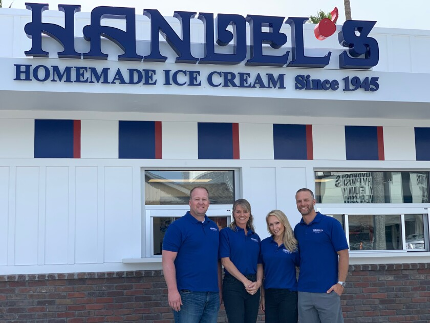 Handel's Homemade Ice Cream franchise owners Marcus and Tammy Weenig, left, and Tarah and Travis Campbell, outside their new Carlsbad Village scoop shop.