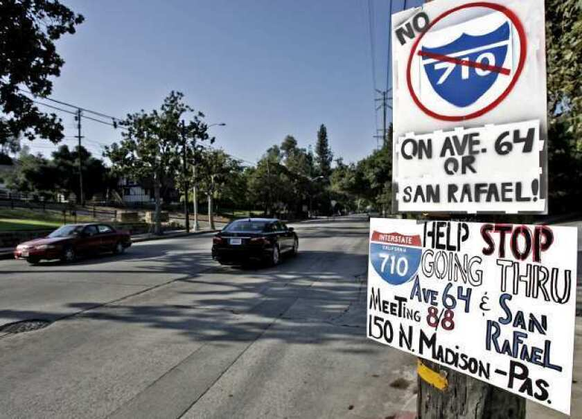 Signs opposing the 710 Freeway being built on Ave. 64 have been placed at the corner of Church St. and Ave. 64 in Pasadena on Wednesday, August 8, 2012.