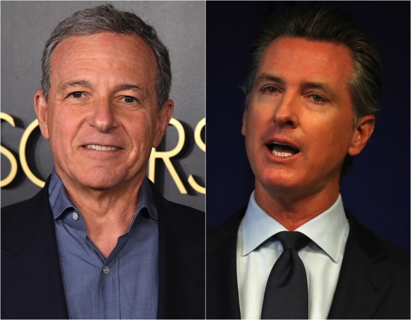 Walt Disney Co. Executive Chairman Bob Iger, left and Gov. Gavin Newsom.