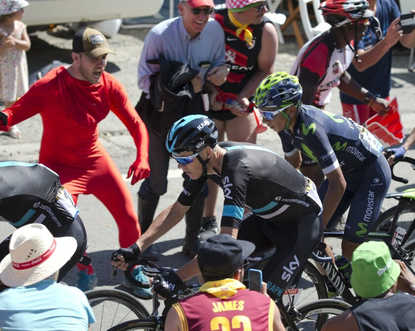 New overall leader Britain's Chris Froome, center, and Colombia's Nairo Quintana climb Peyresourde pass during the eighth stage of the Tour de France cycling race over 184 kilometers (114.3 miles) with start in Pau and finish in Bagneres-de-Luchon, France, Saturday, July 9, 2016. (AP Photo/Peter Dejong)