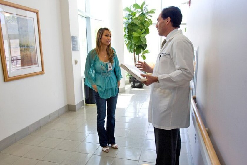 Sothary Van speaks with Dr. Franklin D. Gaylis at Sharp Grossmont Hospital this month. Van attended Miramar College for two years then transferred to UCLA, where she earned her bachelor's. She plans to return to SDSU to get a nursing degree, which she says is a necessary step in order to do the cli