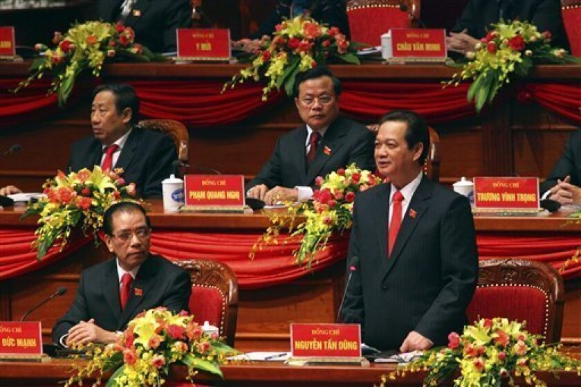 Vietnamese Prime Minister Nguyen Tan Dung, bottom right, delivers speech at the opening ceremony of the 11th National Congress of Communist Party of Vietnam in Hanoi, Vietnam Wednesday, Jan. 12, 2011. The other delegates are outgoing Communist Party General Secretary Nong Duc Manh, bottom left, Foreign Minister Pham Gia Khiem, rear left, and Pham Quang Nghi, secretary of the Hanoi Communist Party unit. (AP Photo/Na Son Nguyen)