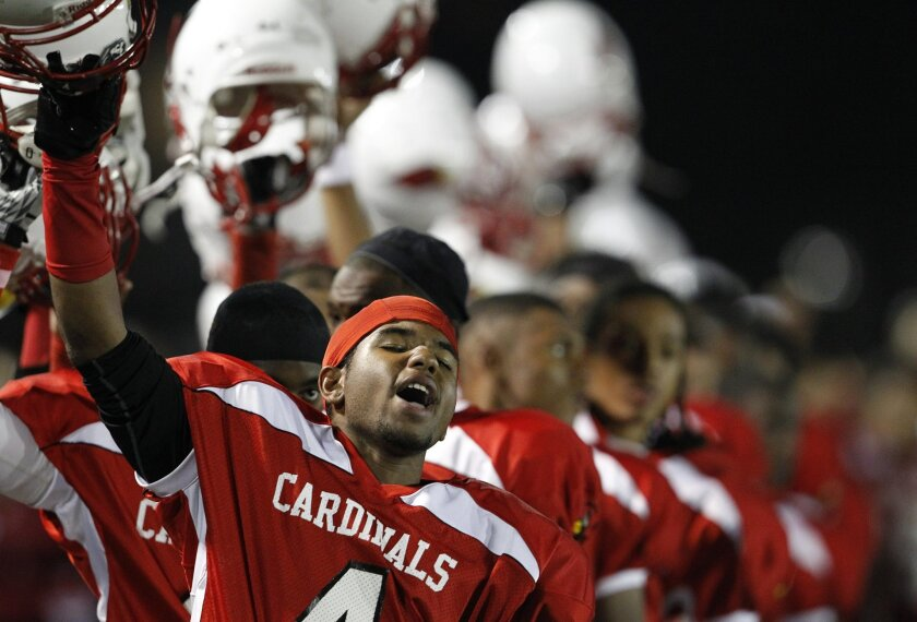 Deshaun Degrate and his Hoover teammates cheer at the end of the national anthem before Friday's homecoming game.