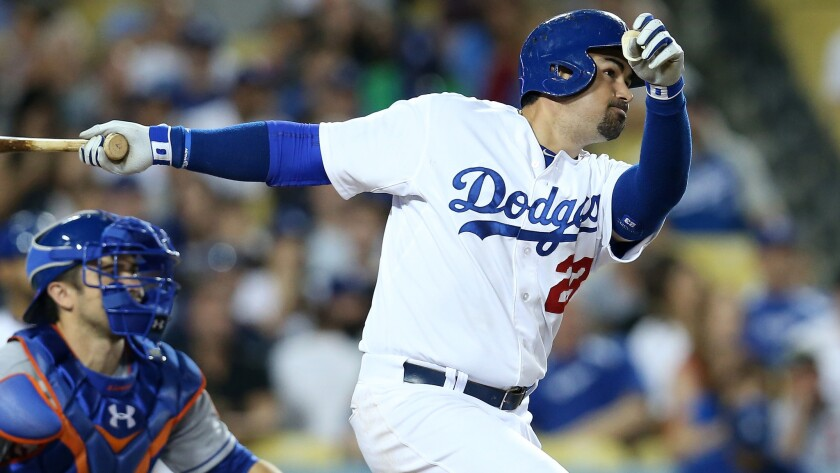 Dodgers first baseman Adrian Gonzalez hits a sacrifice fly in the seventh inning of the Dodgers' 7-4 victory over the New York Mets on Saturday.