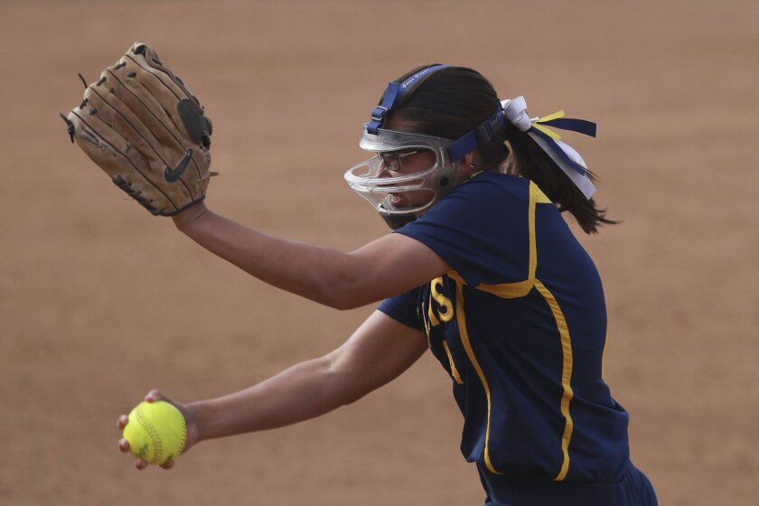 Bonita Vista sophomore Izzy Ortiz has been wearing a protective mask while pitching since age 11.