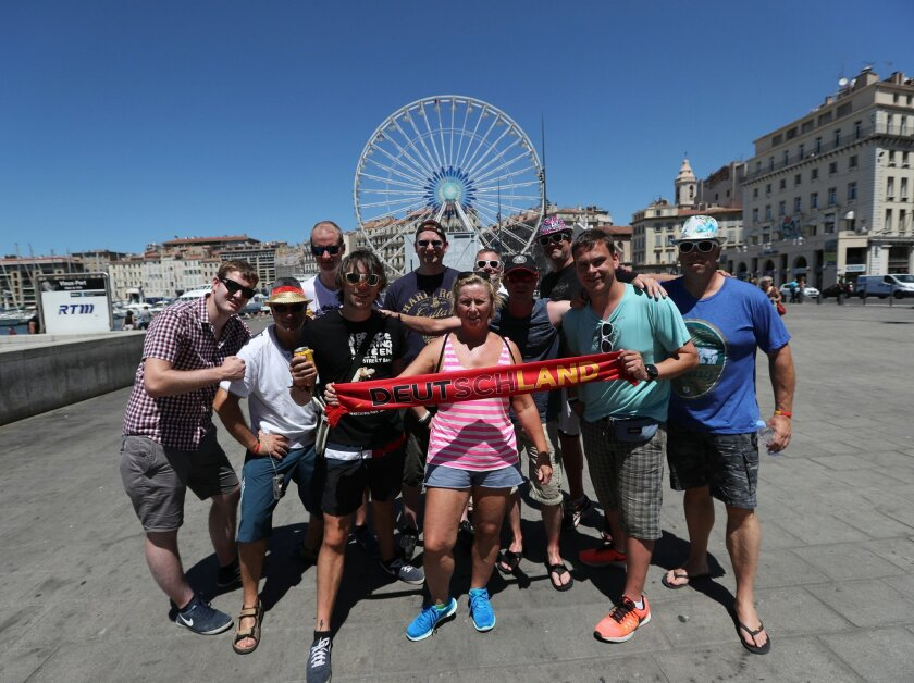 German soccer fans pose for photographers in downtown Marseille, southern France, a day before the world champion takes on the host nation in the European Championship's second semifinal , Wednesday, July 6, 2016. France will face Germany in a Euro 2016 semifinal soccer match in Marseille on Thursd
