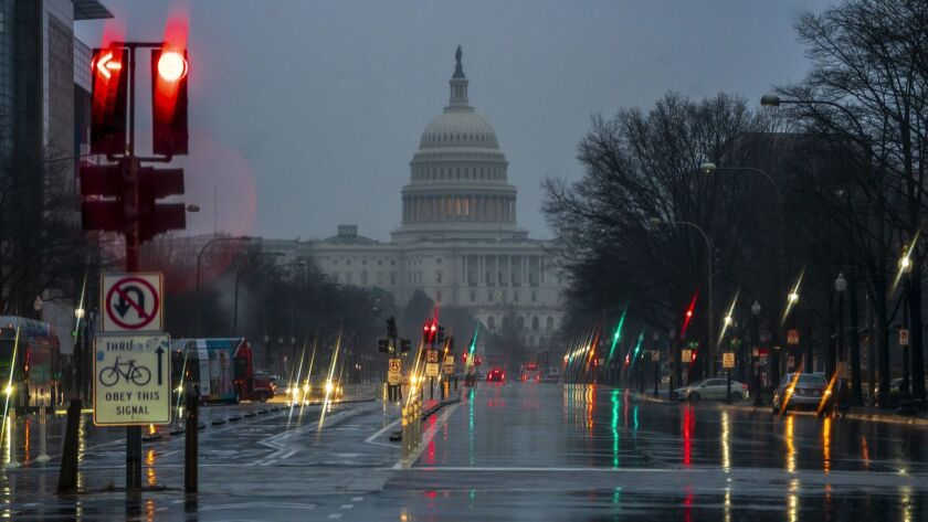 The Capitol is seen on a rainy morning in Washington, Friday, Dec. 28, 2018, during a partial govern