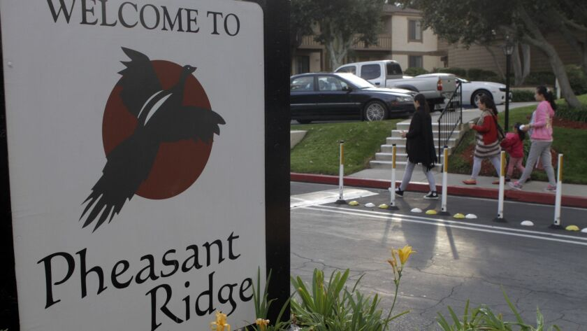 ROWLAND HEIGHTS, CA. DEC. 23, 2012: 3 pregnant women and a young child entering the Pheasant Ridge a