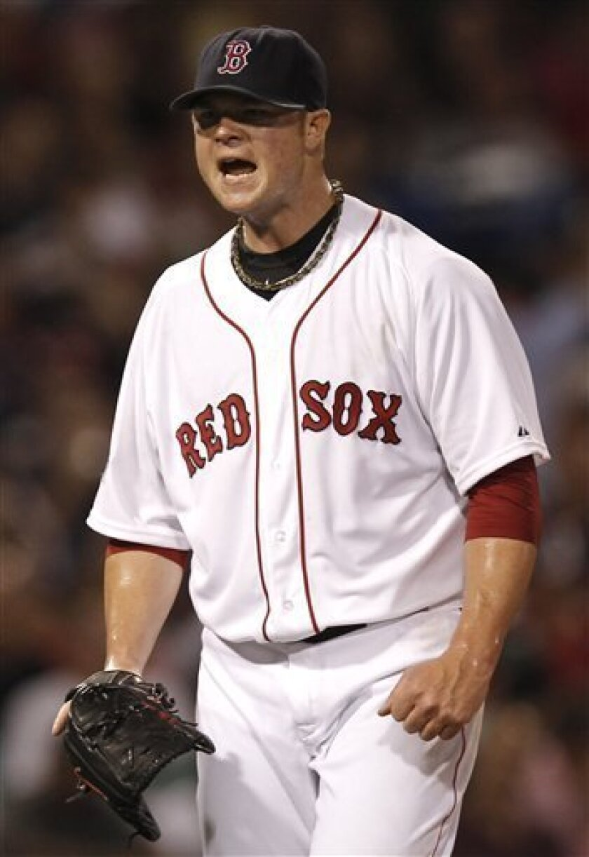 Boston Red Sox starting pitcher Jon Lester shouts after giving up a run during the sixth inning of a baseball game against the Minnesota Twins at Fenway Park in Boston, Thursday, Aug. 2, 2012. (AP Photo/Winslow Townson)