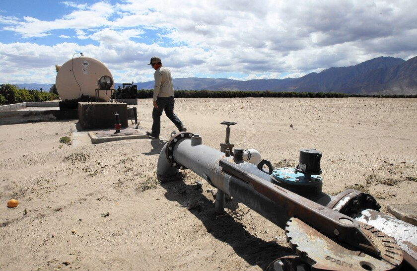 A pipeline carries pumped water serving the Borrego Valley, where years of overdrafting has caused the water table to drop by as much as 119 feet in some areas, with a 26-foot decline in the last decade.