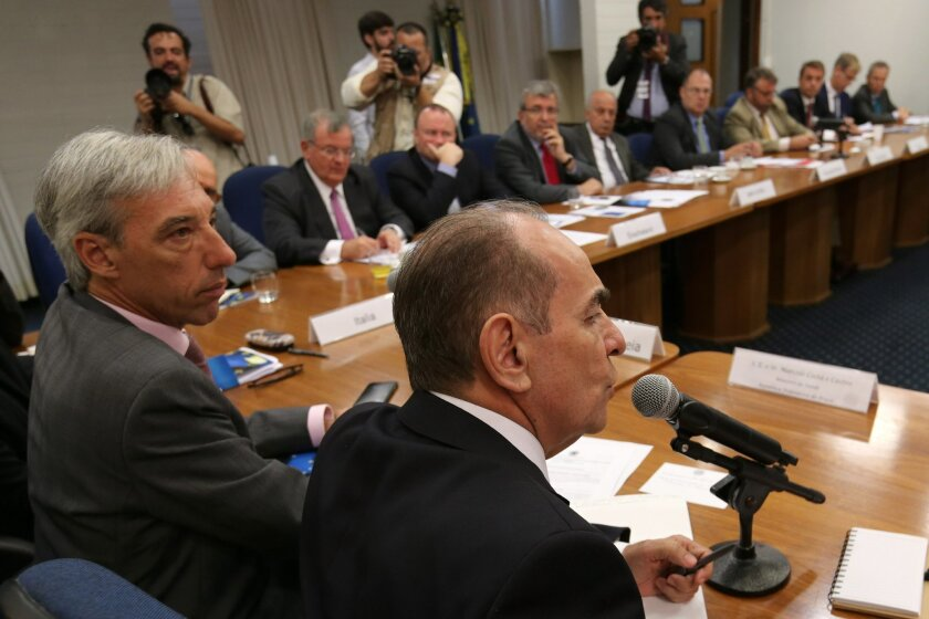 Brazil's Health Minister Marcelo Castro, right, speaks during a meeting with the diplomats of the European Union in Brazil, about measures taken to combat the mosquito that carries the Zika virus, at the headquarters of the European Union, in Brasilia, Brazil, Teusday, Feb. 16, 2016. The virus has