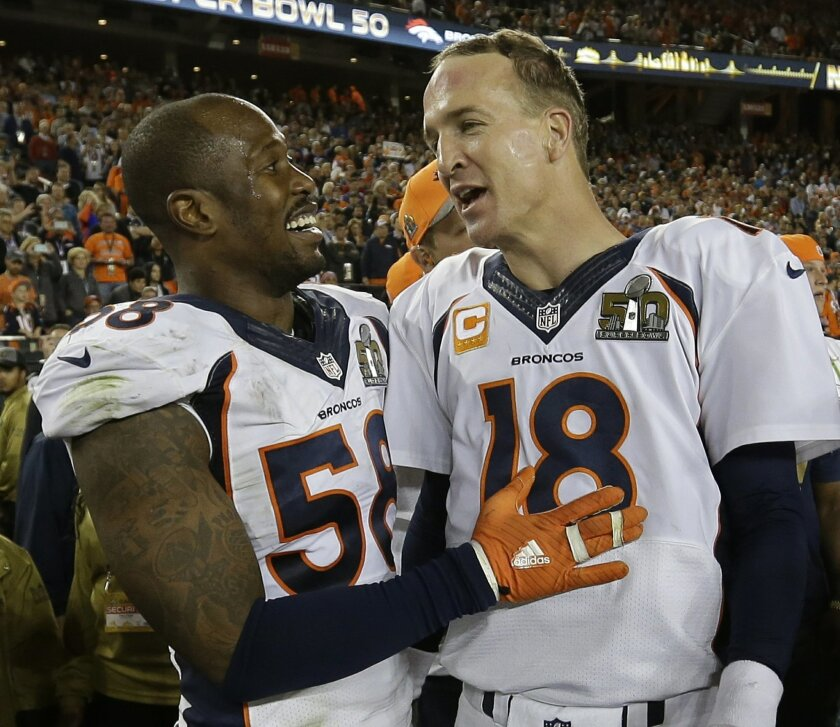 Denver Broncos' Von Miller (58) and Peyton Manning (18) celebrate after the NFL Super Bowl 50 football game Sunday, Feb. 7, 2016, in Santa Clara, Calif. The Broncos beat the Panthers 24-10. (AP Photo/David J. Phillip)
