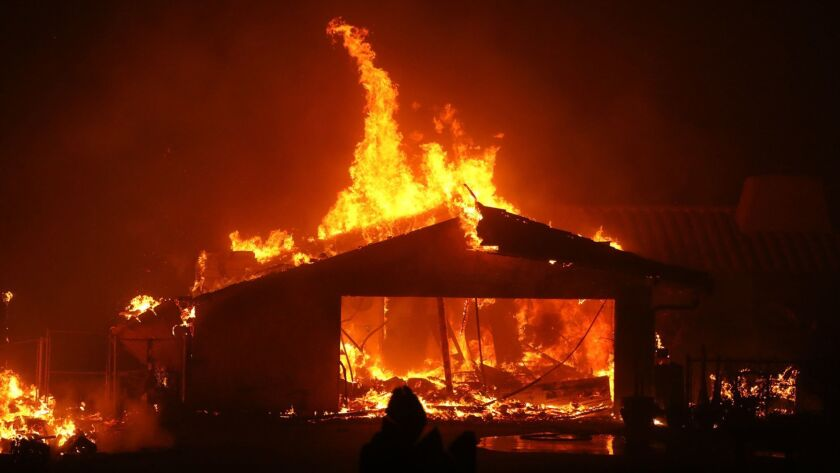 MALIBU, CA - NOVEMBER 9, 2018 - - A home is consumed by the Woolsey fire along the Pacific Coast Hig