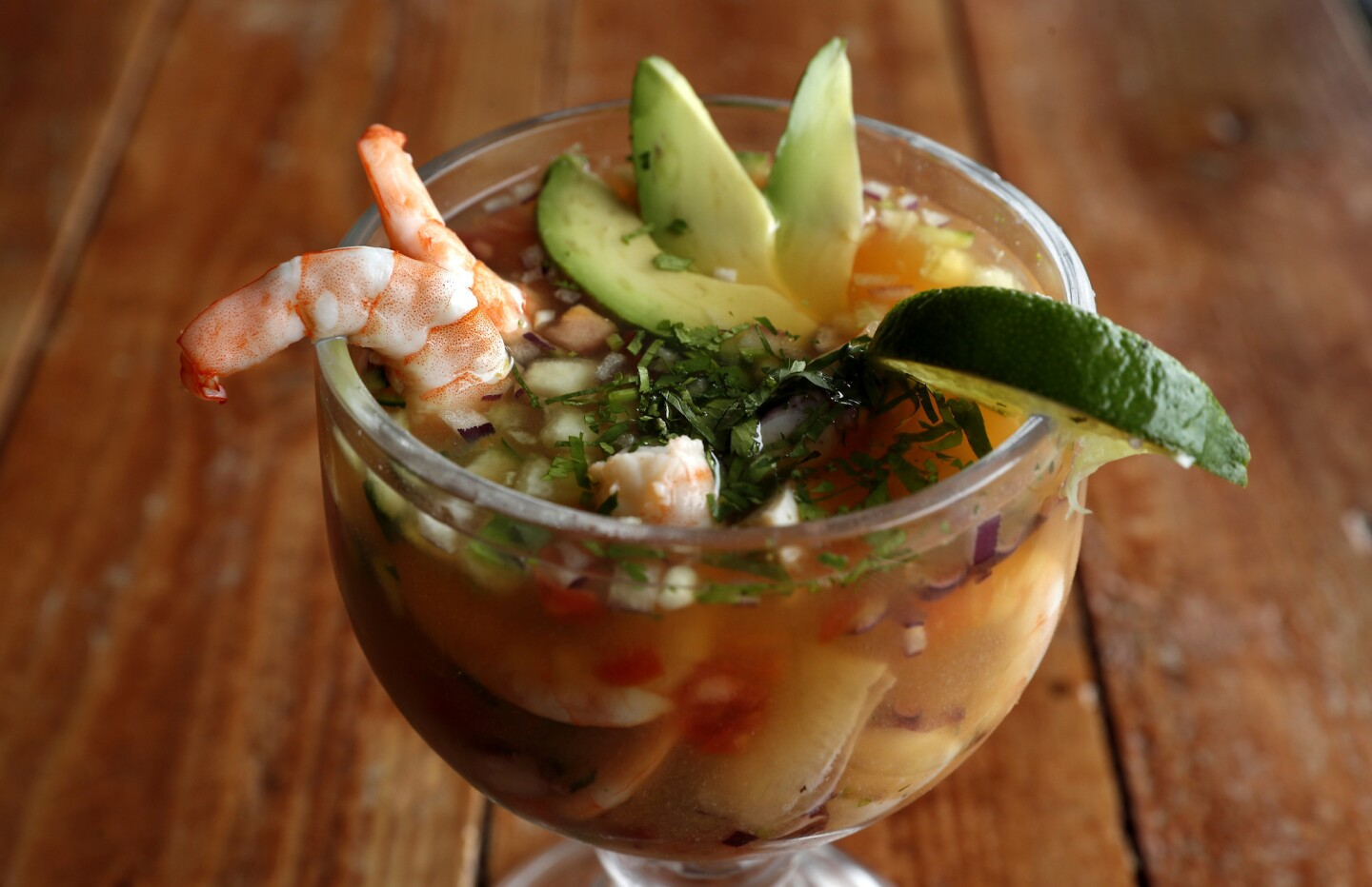 Campechana -- a shrimp, octopus and abalone cocktail -- is on the menu at El Coraloense, a family-run Mexican restaurant in Bell Gardens.