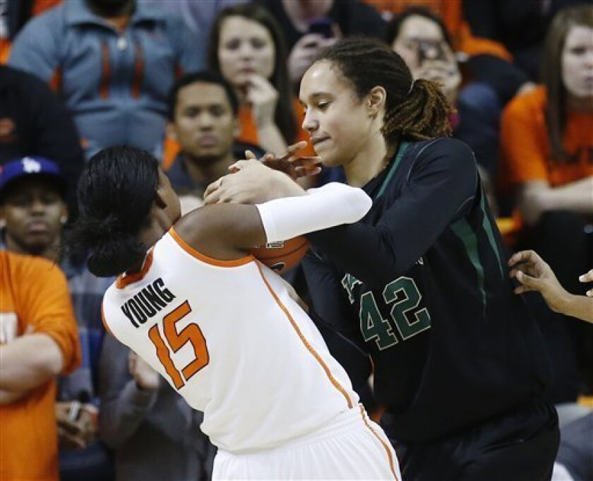 Oklahoma State forward Toni Young (15) and Baylor's Brittney Griner (42) fight for control of the ball in the second half of an NCAA college basketball game in Stillwater, Okla., Saturday, Feb. 2, 2013. Baylor won 81-62. (AP Photo/Sue Ogrocki)