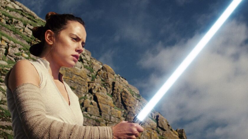 """This image released by Lucasfilm shows Daisy Ridley as Rey in """"Star Wars: The Last Jedi."""" The Skywal"""