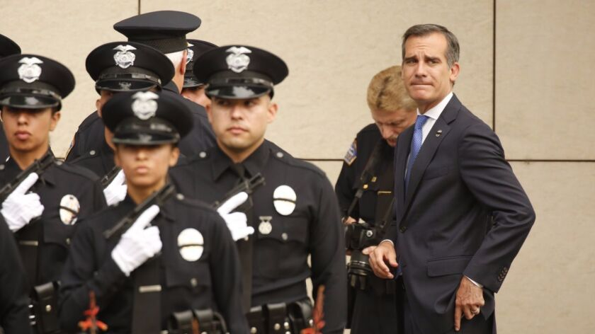 LOS ANGELES, CA - JULY 08, 2016 - Los Angeles Mayor Eric Garcetti looks to protestors as he and LAPD