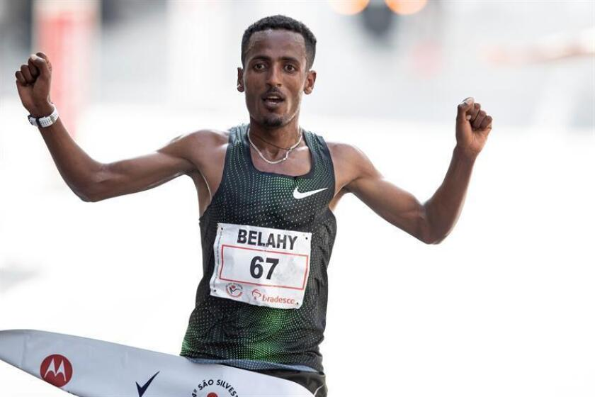 Ethiopia's Belay Bezabh crosses the finish line first to win the men's division of the Sao Silvestre Road Race in Sao Paulo on Monday, Dec. 31. EFE-EPA/SEBASTIÃO MOREIRA