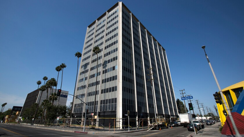 The 13-story former Panorama Towers building, seen here in the Panorama City neighborhood of Los Angeles in June, hasn't been in use since it was damaged in the 1994 Northridge earthquake.
