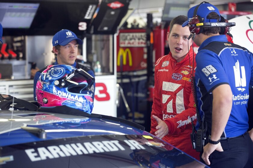 Alex Bowman, center, smiles as he talks with the crew of Dale Earnhardt Jr. before practice Friday July 15, 2016 at New Hampshire Motor Speedway in Loudon, N.H. Bowman will take Earnhardt's place for Sunday's New Hampshire 301 auto race after it was announced that Earnhardt will miss the race due t