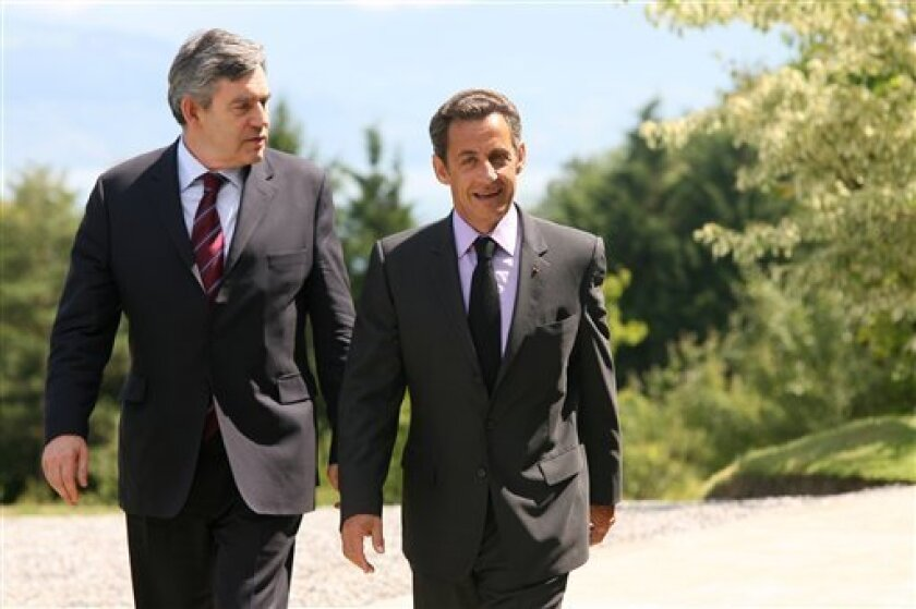 Great Britain's Prime Minister Gordon Brown, left, and French President Nicolas Sarkozy, right, walk during the France Britain Summit, in Evian, French Alps, Monday, July 6, 2009. (AP Photo/Laurent Cipriani)