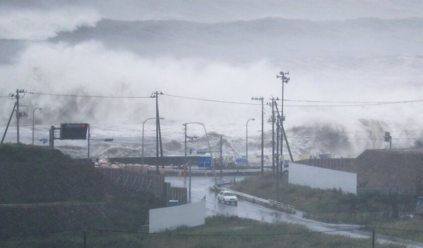 Waves crash against a coast in Ishinomaki, Miyagi prefecture, northeastern Japan, Tuesday, Aug. 30, 2016. A typhoon is about to barrel into northern Japan, threatening to bring floods to an area still recovering from the 2011 tsunami. Typhoon Lionrock has already paralyzed traffic, caused blackouts