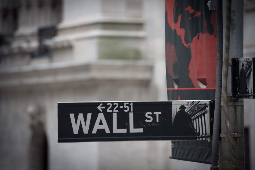 The Wall Street sign near the New York Stock Exchange.