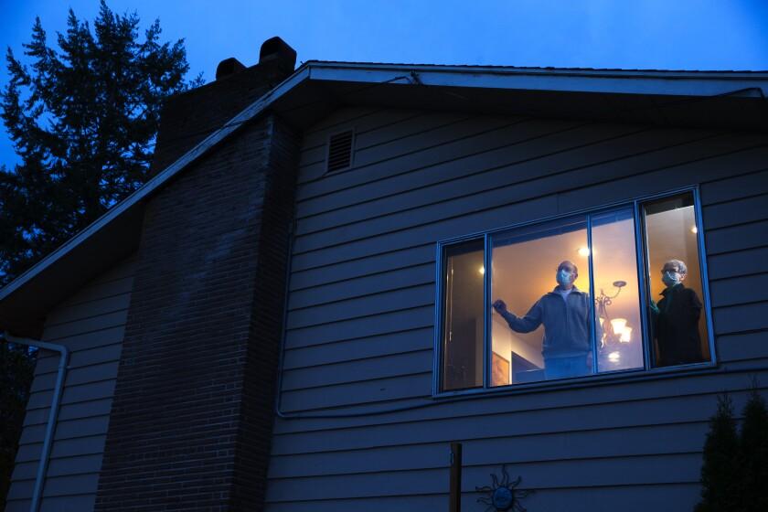 Pat and Bob McCauley self-quarantine at their home in Kirkland, Wash.