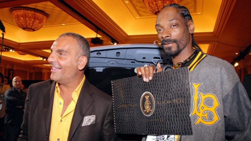"""Christian Audigier and Snoop Dogg in a still from """"Christian Audigier the Vif"""" movie."""