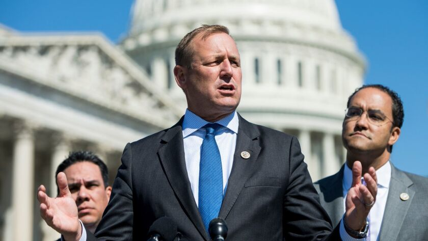 Rep. Jeff Denham (R-Turlock), flanked by Reps. Pete Aguilar (D-Redlands) and Will Hurd (R-Texas), on Capitol Hill in April.