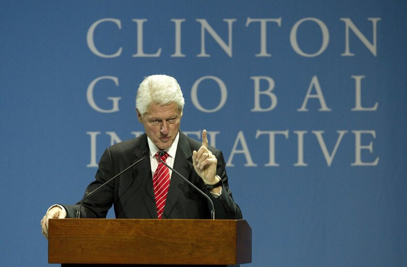 Former President Bill Clinton addresses students gathered at UCSD Friday night for the Fourth Annual Clinton Global Initiative University meeting.