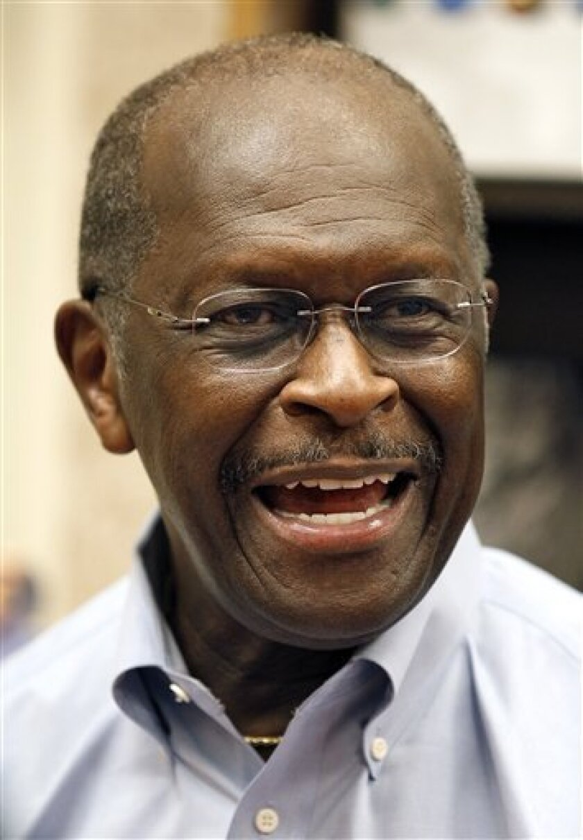 Republican presidential candidate businessman Herman Cain answers a question during a book signing Wednesday, Oct. 5, 2011, in St. Petersburg, Fla. Rick Perry's loss has been Cain's gain. As the Texas governor has tumbled in polls for the Republican race for president, Cain has enjoyed a surge in support from a restless Republican electorate. (AP Photo/Chris O'Meara)
