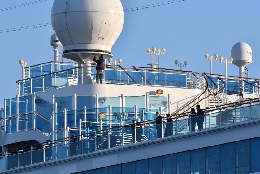 Passengers on the deck of the Diamond Princess on Feb. 13.