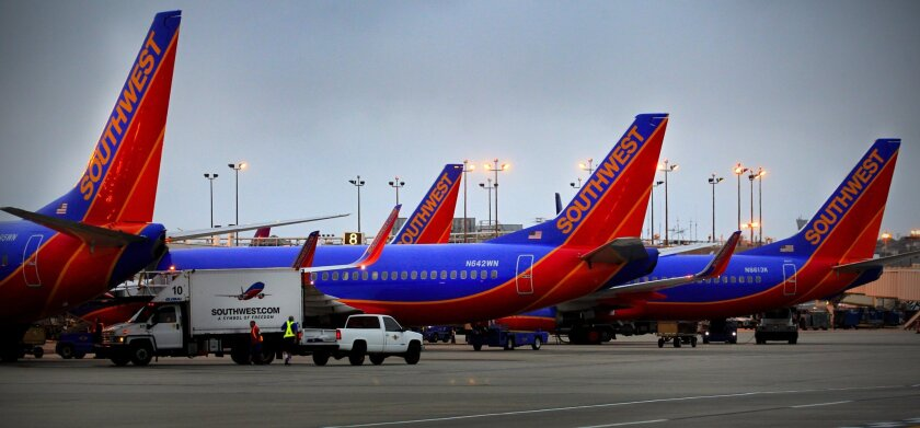 San Diego International Airport, city government, and the San Diego Regional Chamber of Commerce, announced a partnership with New American Workforce to help eligible employees become naturalized U.S. Citizens. Here, Southwest Airlines planes are parked at Terminal 1.