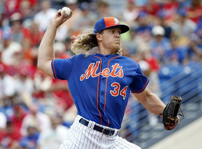 New York Mets' starting pitcher Noah Syndergaard throws during the first inning of an exhibition spring training baseball game against the St. Louis Cardinals, Friday, March 25, 2016, in Port St. Lucie, Fla. (AP Photo/Brynn Anderson)