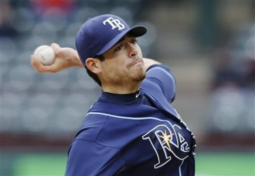 Tampa Bay Rays starting pitcher Matt Moore delivers to the Texas Rangers in the first inning of a baseball game Wednesday, April 10, 2013, in Arlington, Texas. (AP Photo/Tony Gutierrez)