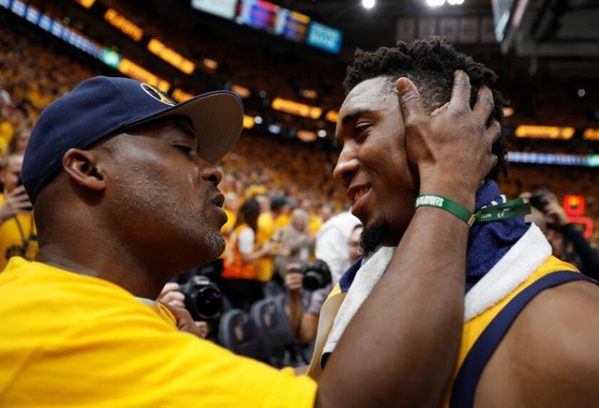 Utah Jazz guard Donovan Mitchell (R) gets hug from his father after the Jazz defeated the Oklahoma City Thunder during the NBA Western Conference First Round playoff game six at Vivint Smart Home Arena in Salt Lake City, Utah, USA, 27 April 2018. EFE