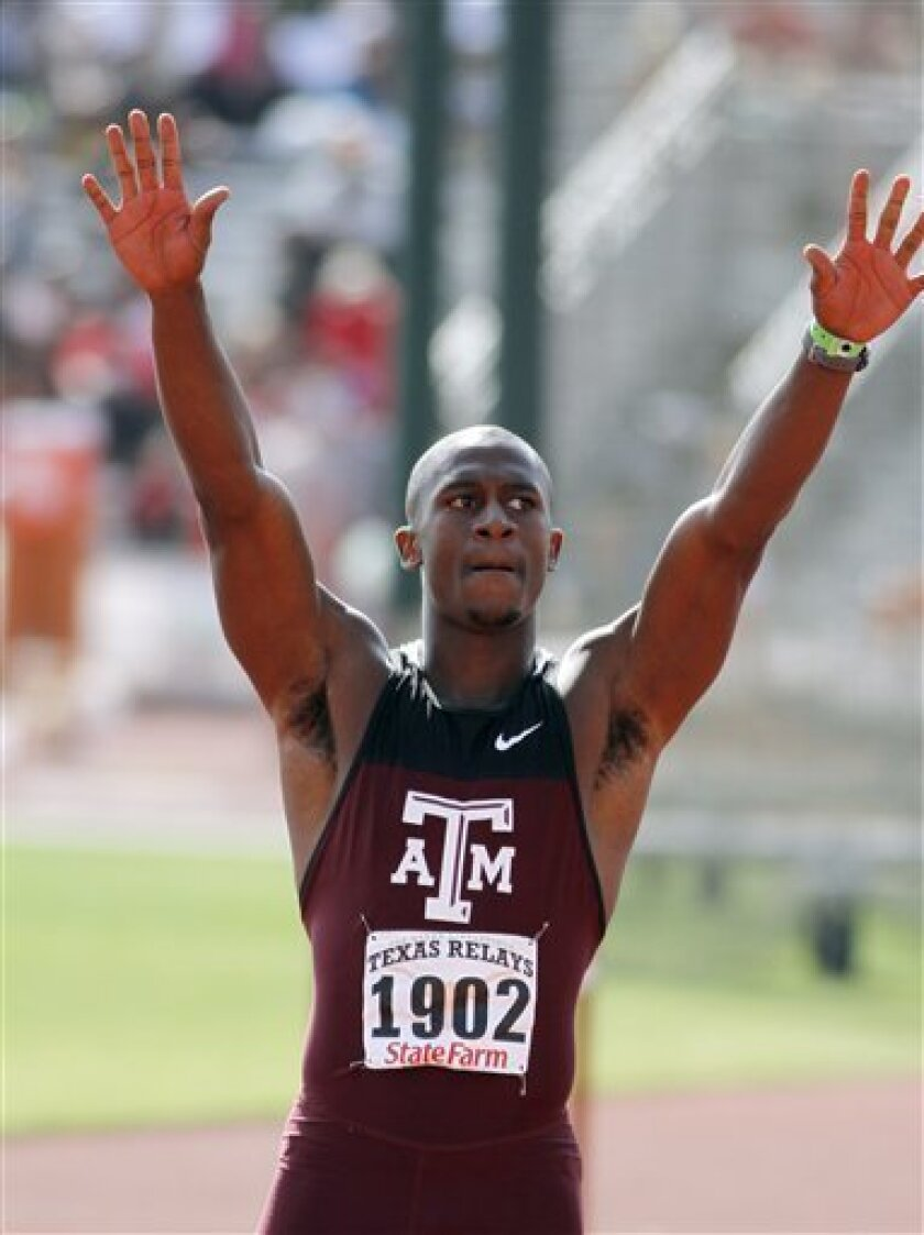 Texas A&M's Gerald Phiri wave to the crowd after winning the university men's 100-meter dash at the Texas Relays athletics meet with a time of 10.06 seconds in Austin, Texas, on Saturday, April 9, 2011. (AP Photo/Jack Plunkett)