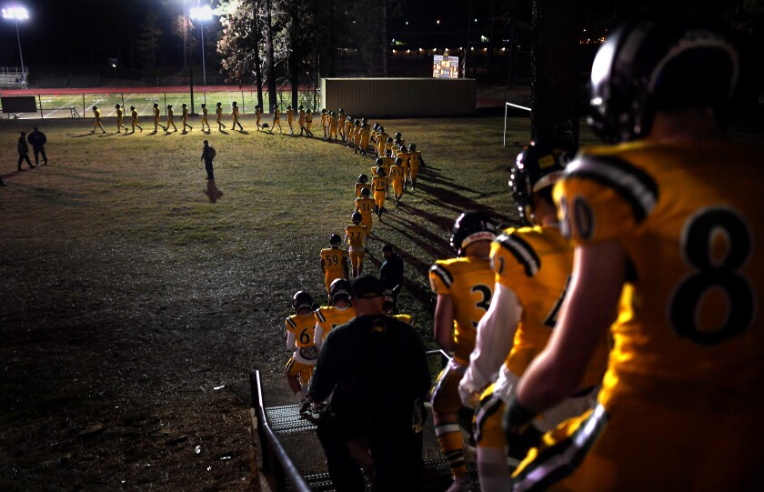 The Paradise football team makes it way to the field before a playoff game.