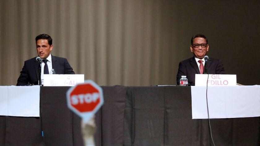 Bicycle activist Joe Bray-Ali, left, and Los Angeles City Councilman Gil Cedillo at a candidate forum in February.