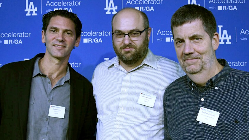Former Dodgers outfielder Shawn Green, left, with Greenfly co-founder Daniel Kirschner, center, and Stephen Plumlee, the company's chief operating officer.