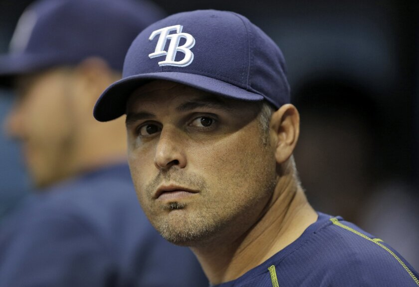 FILE - In this Sept. 29, 2015, file photo, Tampa Bay Rays manager Kevin Cash looks on during the first inning of an interleague baseball game against the Miami Marlins,  in St. Petersburg, Fla. Second-year manager Kevin Cash will spend training trying to determine how all the new bats fit best. (AP