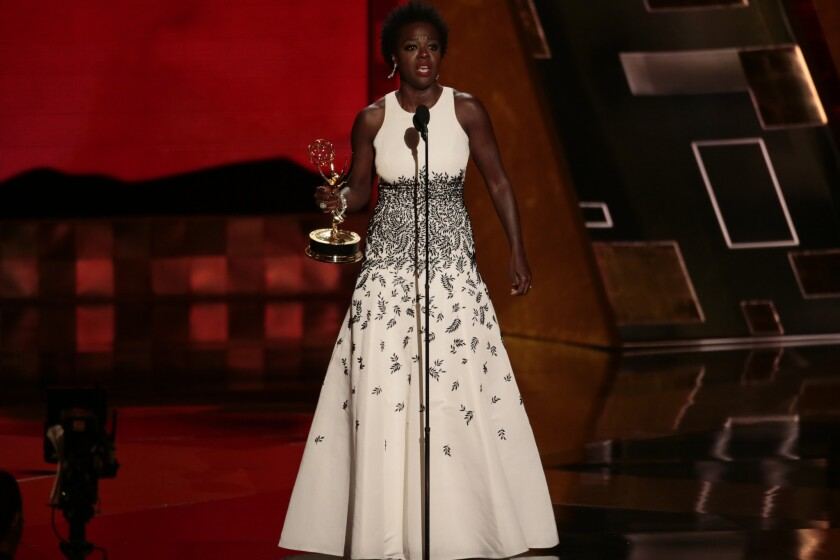 "Viola Davis accepts the award for outstanding lead actress in a drama series for ""How to Get Away With Murder."" In accepting her honor, Davis said, ""The only thing that separates women of color from anyone else is opportunity."""