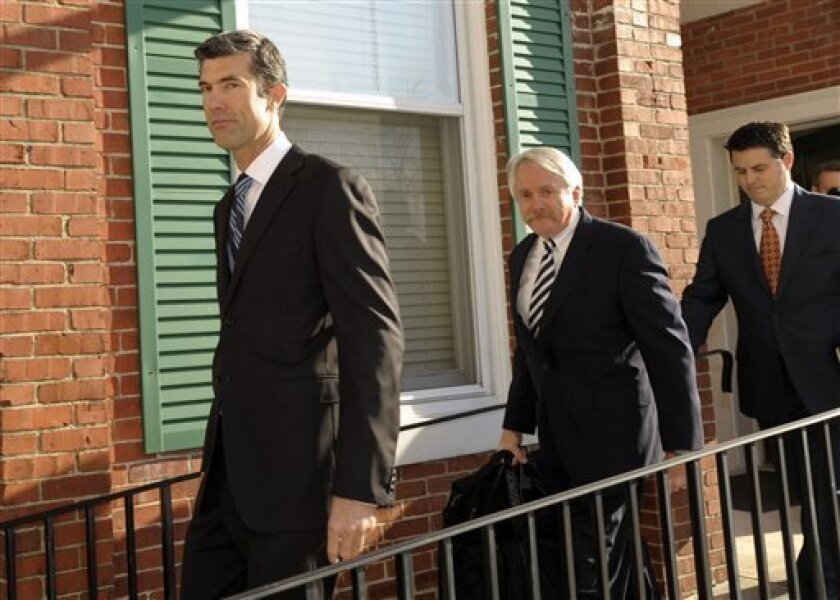 Craigslist CEO James Buckmaster, left, followed by attorneys, arrives to testify in the civil trial between eBay and Craigslist in Delaware's Chancery Court Monday, Dec 7, 2009, in Georgetown, Del. (AP Photo/Bradley C Bower)