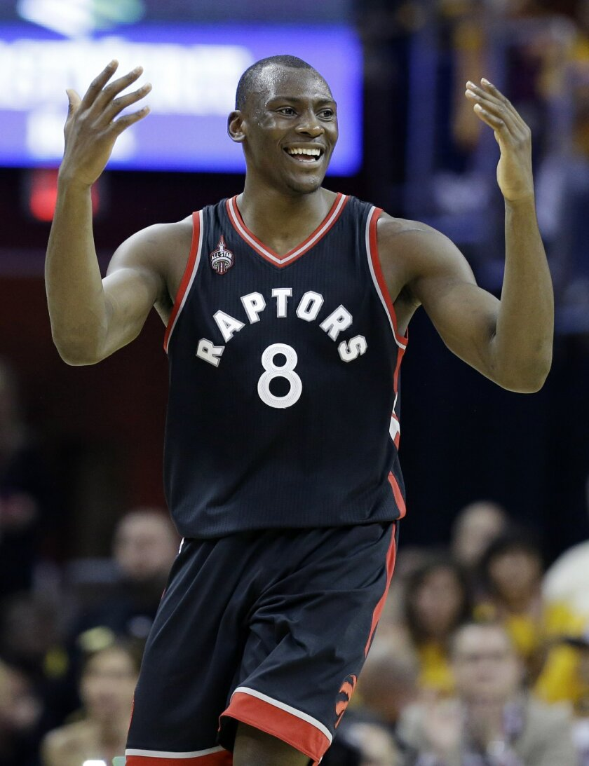 Toronto Raptors' Bismack Biyombo (8) reacts to a call against Toronto, during the first half of Game 5 of the NBA basketball Eastern Conference finals between the Raptors and the Cleveland Cavaliers on Wednesday, May 25, 2016, in Cleveland. (AP Photo/Tony Dejak)
