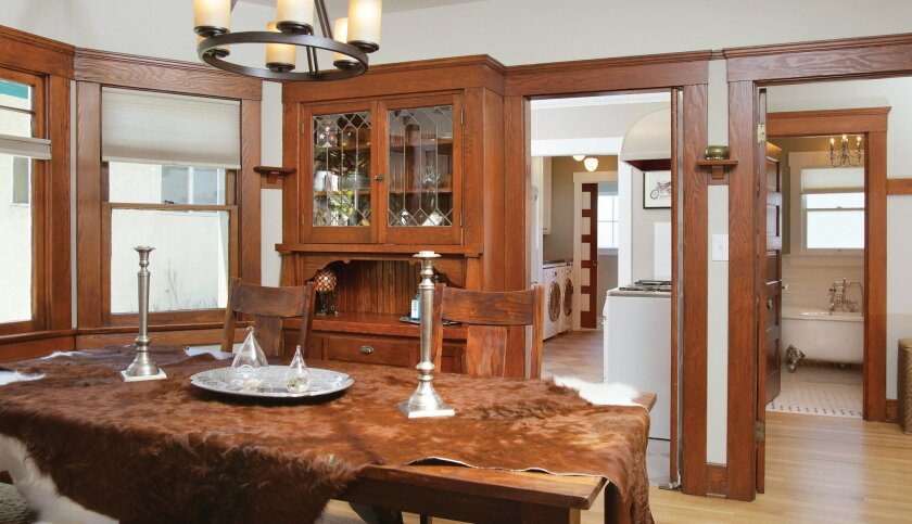 The dining room with all its original woodwork has been lovingly restored.