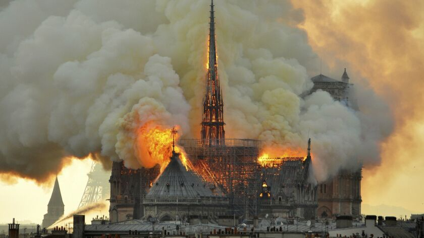 In this image made available on Tuesday April 16, 2019 flames and smoke rise from the blaze at Notre