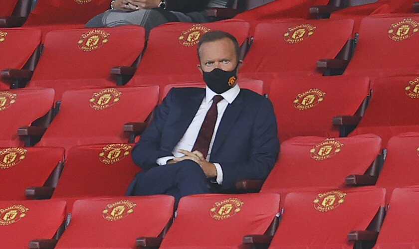 Manchester United Chief Executive Ed Woodward watches on during the English Premier League soccer match between Manchester United and Crystal Palace at the Old Trafford stadium in Manchester, England, Saturday, Sept. 19, 2020. (Richard Heathcote/Pool via AP)