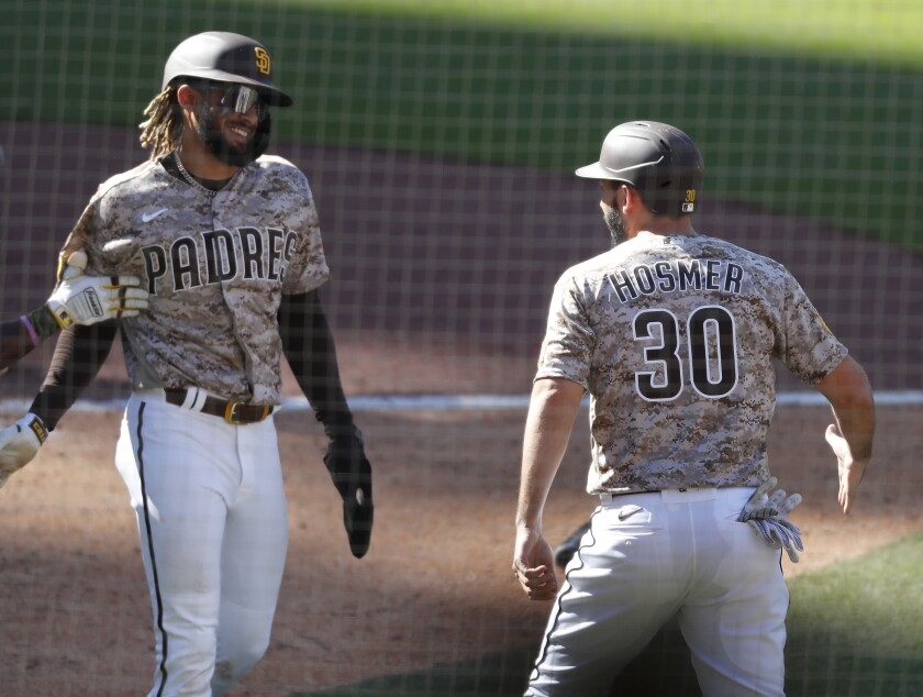 Fernando Tatis Jr. (left) and Eric Hosmer celebrate during a 5-2 win Sunday against the Dodgers at Petco Park